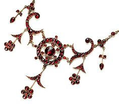 Romantic Edwardian Bohemian Garnet Necklace - the shape/ flow of the central components, imagining something similar in polymer with Skinner blend canework, finely textured inner ring in duo color (effect like taffeta) , outlines in faux leather, earthy palette