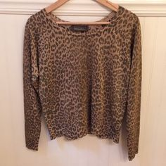 """Anthro Charlotte Tarantola Metallic Sweater Sz M  Charlotte Tarantola from Anthropologie    Size Medium   Metallic, leopard print sweater. Lightweight. Slightly cropped in length - 21.5"""" from shoulder to hem.   Excellent used condition!    Rayon, polyester & metallic blend   Bust: 18.75"""" across the front, lying flat.    Length: 21.5"""" from shoulder to hem.   ✳️ Bundle to Save 20%!  ❌ No Trades, Holds, PP   100% Authentic!    Suggested User // 800+ Sales // Fast Shipper // Best in Gifts Party…"""