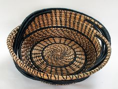 - Windy: This basket is made of pine needles and black thread....