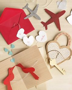 How to Make the Pull Their Heartstrings Valentine's Cards by Martha Stewart Crafts... Easy and unique...   An airplane chased by a lovey-dovey contrail, a heart-shaped lock with skeleton key, two little lovebirds sitting on a wire -- these garland-style cards simply require ribbon, cord, or twine. Mixing patterned and solid-color papers helps create contrast and adds visual interest.