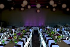Great rustic wedding! Purple uplighting, burlap table runners, wine bottle candle holders and bright punches of color.     Get this look at www.designyourweddingday.com