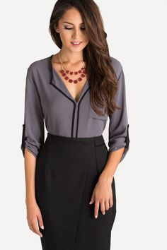 I like the vertical lines at the midline.  I also like the colorful accent necklace with the neutral outfit.