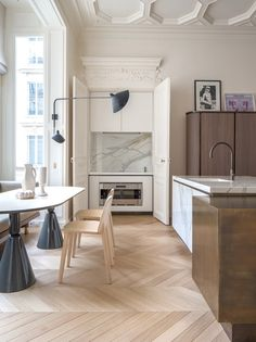 The refurbishment of an 18th-century apartment in the French capital results in an eclectic and radiant space.
