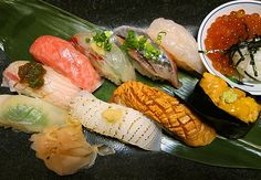 nigiri, gunkan and small dish filled with ikura