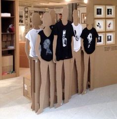 Cardboard/Particleboard mannequin cutouts with each product displayed. For outside of the store under future TV