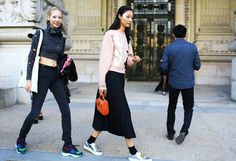 Soo Joo Park and Ji Hye Park in an Acne top and shoes
