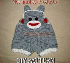 so stinking cute!! there is even a tail on the back!!  Baby Sock Monkey Overalls,Buttons at leg pattern on Craftsy.com $4.95