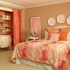 After Makeover: All-Pink Palette  An attention-grabbing duvet in shades of pink pairs with bold pillows to liven the pink and tangerine palette. Pretty plates adorn the walls above the bed and add a touch of elegance.