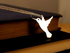 A delicate fine silver humming bird pendant on a 40cm (16 inch) sterling silver chain. The bird measures 28 x 22mm.