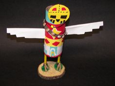 Fourth grade students created kachinas as part of their study of  Native Americans.  They looked at several hand made kachinas and photos of authentic kachinas for ideas.  The body is made of recyc...