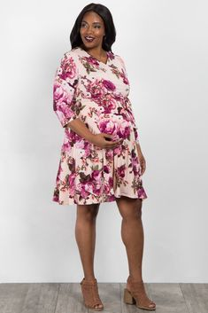 This floral plus maternity dress is perfect for any occasion this season. This dress is perfect for nursing your little one and will easily transition with you during and after pregnancy. With its gorgeous floral print and comfy material, you'll look and feel beautiful. Pair with wedges and a cute necklace to look super stylish.
