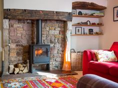Yanwath Gate Farm has fantastic traditional wood burners throughout the property. This is the living room's cosy wood burning stove with logs provided.