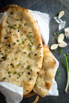 Homemade Garlic Naan | A chewy homemade naan bread covered in fresh minced garlic and green onions.