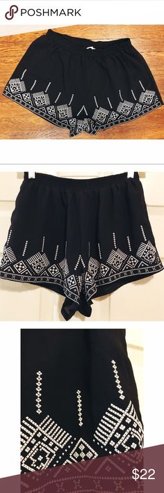 Entro • NWOT Shorts Entro • NWOT Shorts. Black and white detailing on the front side. Back is all black. Cute chiffon flowy style. Elastic waist. Size small. Entro Shorts
