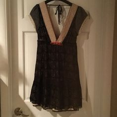 Dress Beautiful Free People black lace dress. Deep V front and back with a lace tie. It states a size 12 but really fits a size 4-6. It has a cream lining to match the lace around neck and sleeves Free People Dresses Mini