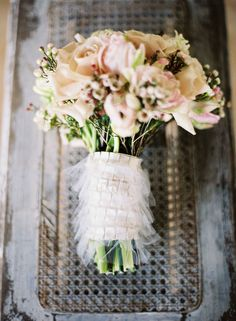 i love small bouquets for the bridesmaids. i think i want to wrap those in tulle SIMILAR to this.