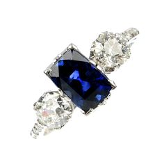 An early 20th century sapphire and diamond three-stone ring.