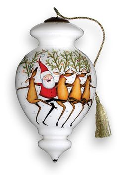 The Cancan Santa--Ne'Qwa brings you the centuries-old tradition of reverse hand-painting on the inside of glass. The same meticulous techniques that captivated emperors and art connoisseurs ages ago are used to individually create each one of these amazing Santa ornaments.