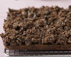 This chocolate rough slice is a delicious combo of chocolate base and a sweet coconut topping that cuts down to 24 yummy slices.