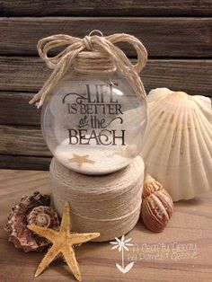 Life is Better at the Beach Floating Ornament. Could decorate these beforehand and give them out at the family party, to be filled with beach sand.