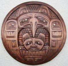 Circular Hawk with Bear Carving