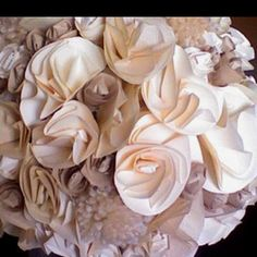 The whole thing is made out of paper!!     You can use these in your entire wedding! Pomanders to line the aisle, decor for the altar, even Bride and Bridesmaid bouquets!    http://www.projectwedding.com/wedding-ideas/diy-wedding-challenge-2010-paper-flower-bouquets