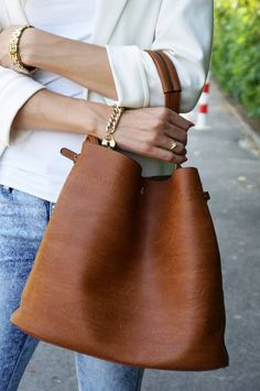 big leather tote. LOVE the shape - I've been looking for a tote like this.