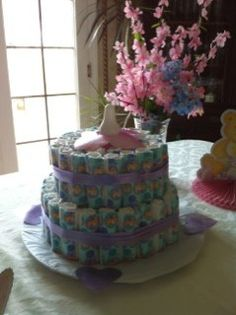 Diaper cake:  Large Baby Bottle coin bank for center (battery powered Christmas candle in bottle for flickering light); rolled diapers in two layers for cake.