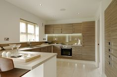 The open plan kitchen, dining and family area is a great space to entertain family and friends. #Strata
