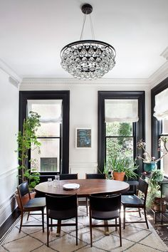 I love every inch of this Cobble Hill townhouse designed by Blair Harris. The black trim in the...
