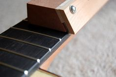 Here's a simple device for bevelling the end of the frets on a guitar fingerboard. This webpage has several other intrument building jigs and tools. Easy Guitar Tabs, Guitar Diy, Guitar Shop, Box Guitar, Music Guitar, Acoustic Guitar, Guitar Neck, Making Musical Instruments, Homemade Instruments