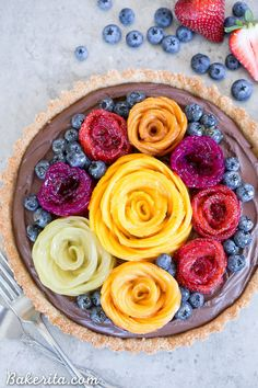 This Chocolate Mousse Tart with Coconut Crust + Fresh Fruit Flowers has the most incredible vegan chocolate mousse filling! You'd never guess that this rich dessert is gluten-free, Paleo, and vegan.