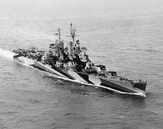 Cleveland class USS Duluth (CL 87) in camouflage-Measure 32, Design 11a, underway in the Hampton Roads area, Virginia, October 10, 1944.