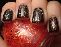 Sinful ~ Red Ocean over a black base. I love glitter over black nail polish. Looks great.