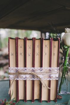 #Vintage books for a forest elopement | Photography: Hyer Images - hyerimages.com  Read More: http://www.stylemepretty.com/little-black-book-blog/2014/05/22/intimate-southern-forest-elopement/