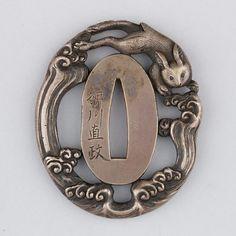 Sword Guard (Tsuba) Date: ca. 1615–1868 Culture: Japanese Medium: Silver, copper Dimensions: H. 2 ¼ in. (5.7 cm); W. 1 7/8 in. (4.8 cm); thickness 5/16 in. (0.8 cm); Wt. 2.4 oz. (68 g)