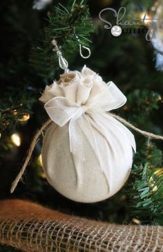 Christmas ornament DIY: wrap it in fabric and tie the top with string i could use all my styrofoam balls and add embellishments like ribbon string or bells and greenery to this ornament