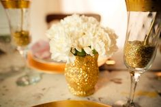 DIY Gold and silver glitter vases for cocktail hour. Fill with baby's breath and/or white carnations?