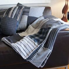 I really hate to be wasteful. Post-winterpurging timeof sweaters and also my son's birthday,hatched a bright idea. Previously-loved sweaters are cozy and warm, so why not give them a second life? Up-cycling is sorewarding. My son's decor is grey tones…