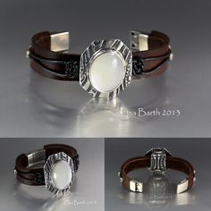 This is a Mother of Pearl cab bezel set in fine silver. The bezel was embedded in wet metal clay and then fired with investment to hold the contour. The leather is hand cut, dyed, and tied to the center piece so it will not slip around on the bracelet.