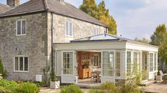 30 Bright and Beautiful Sunroom's Farmhouse Design Ideas Do you want to try a new inspiration for your home? or maybe your house has long you do not renovate and want your renovation. Or maybe your house lacks the intake of more light to keep your house … Orangery Conservatory, Conservatory Extension, Orangery Extension Kitchen, Garden Room Extensions, House Extensions, Interior Exterior, Exterior Design, Orangerie Extension, Sunroom Addition