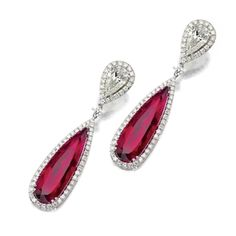 PAIR OF RUBELLITE AND DIAMOND PENDANT-EARCLIPS. The tops set with 2 pear-shaped diamonds together weighing approximately 2.90 carats, supporting 2 pear-shaped rubellites weighing approximately 14.50 carats, all framed by small round diamonds, mounted in 18 karat white gold.