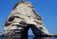 There are about 30 sea arches around the Greek Island of Milos. Probably the most beautiful area is Kleftico in the southwest part of the island, containing numerous arches and sea tunnels accessible only by boat. The first three photos on this page were taken at Kelftico