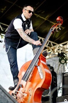 Standing up on the stand up double bass. And I am starting to fall in love <3 Nothing hotter than a wild rockin man playing bass...