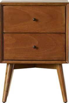 $154 | This wood nightstand's tapered legs  offers midcentury appeal for your master suite. Let it stand out among your traditional bedroom furnishings for a new take on timeless, or go bold and pair it with other animal prints and hides (think: zebra rug, leopard pillows, or sumptuous sheepskins) for a luxe feel.