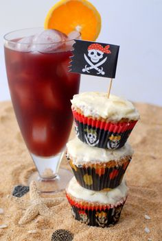 Drunken Sailor Rum Cupcakes with Pineapple Frosting and a Rum Runner cocktail ~T~ I'm there.