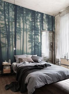 Discover calming interior design with a moody forest wallpaper. Featuring a sea of trees in deep misty hues, this wallpaper can transform any room into a serene hideaway. Display on a tall wall to feel the maximum impact of this mysterious mural. Location: Aubergine Studios