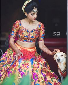 A coordinated lehenga with colourful floral patterns on the lehenga skirt and the blouse. Moreover, the blue peacock motifs make the outfit look prettier as it contrasts well with the orange banarasi fabric. Lehenga Blouse, Saree Dress, Lehenga Skirt, Anarkali, Bridal Lehenga, Saree Wedding, Wedding Attire, Nauvari Saree, Dads