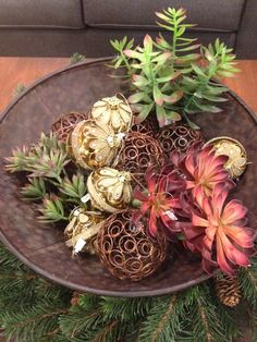 Add a wreath for beneath your bowl and foliage and ornaments for inside to make your center piece festive.