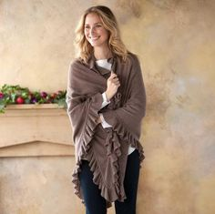 """PORTRAITURE CASHMERE WRAP--The wrap is a cold-weather staple—perfect for dashing out the door on chilly mornings or sofa-snuggling on Sunday afternoons. Ours is knit of lush, plush cashmere edged in an abundance of soft ruffles, taking this versatile layer to a sublime new level of luxury. Dry clean. Imported. One size fits most. Approx. 37""""L."""